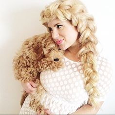 """Who says dogs aren't a woman's' best friend?! How adorable is this pup cuddled up to @mrs_laurenmcmullen! Lauren is wearing her 24"""" Bleach Blonde Luxies in the perfect Side Dutch Braid!   Photo credit: https://instagram.com/mrs_laurenmcmullen/  #DutchBraid #BraidedHairstyles #LuxyHairstyles"""