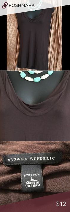 "Banana Republic Top Size L Banana Republic Top Size L.  Stretchy.  Color: brown Material: 95% rayon 5% spandex.  Measurements: Bust 19"" (armpit to armpit), Length 25"" (top of collar down), Sleeveless. From a pet-free / smoke-free home. Banana Republic Tops"