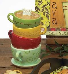 Java Time Cookie Jar, by Certified International. Features the whimsical, coffee-themed, mixed media artwork of Lisa Kaus! This is for the Cookie Jar, shaped like color stacked coffee cups. Stands 11 inches tall.