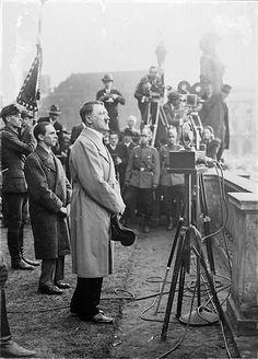 Hitler and Goebbels in Berlin, 1932. Note the newsreel cameramen.