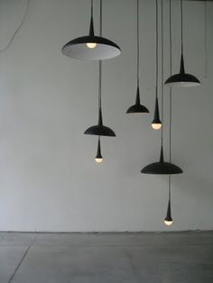 grouped pendant lights + all black