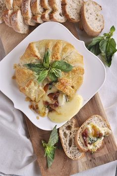 """<a href=""""http://www.yourhomebasedmom.com/basil-bacon-peach-baked-brie/"""" target=""""_blank"""">Basil, bacon, and brie</a> finally found a home inside a pastry puff."""