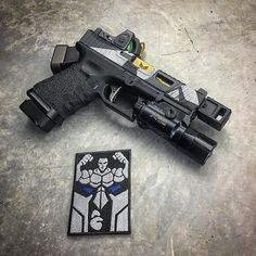 Still one of my favorite builds! Repost Awesome new Thin Blue Line (police support) patch from my friend at With the Glock Glock Specs: 19 gen 3 Compensator: Micro Comp Slide: Barrel: Optic: RMR 06 Trigger: Magwell: Grips: Ammo: Light: Glock Mods, Agency Arms, Custom Glock, Future Weapons, Assault Weapon, Concept Weapons, Apple Wallpaper, Tactical Knives, Guns And Ammo