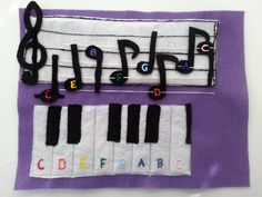 Music notes and piano page - the music notes are all on strings and can slide to different positions.