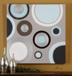 Frameless, hand painted artwork on canvas that has been stretched and attached to wooden stretching bars. Due to the handcrafted nature of this artwork, each piece may have subtle differences. Designer: Eve  Dimensions: 40 W X 40 H X 2 D (in)  www.garbes.com
