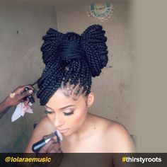 Bow Hairstyle with Box Braids - Turn your hair into a bow hairstyle without having to use accessories like headbands, scarves, and ribbons.