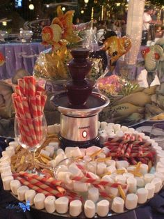 Chocolate fountain for the dessert bar. Marshmallows capture the brides' memories of her backyard camp-outs as a child. Deco Buffet, Dessert Buffet, Dessert Bars, Chocolate Fountain Bar, Chocolate Fountains, Chocolate Fondue, Hot Chocolate, Candy Table, Candy Buffet