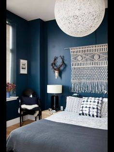 Like the strong blues and greys, and contrast with the white. Also like the tapestry and accessories - it has a worldly, travelly feel.