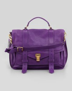 This purple handbag is beautiful.  Wish I could find one for me that wouldn't break the bank.