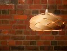 A pendant light shade hand made in the Bay of Plenty. Crafted from sustainable, plantation grown New Zealand pine, copper pins, bamboo fastening clips and recyclable polyproplene lampholders.   Each piece is hand made by me. I have chosen my materials carefully with sustainability and recycling in...