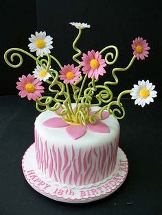Pink zebra stripe with gerber daisies cake