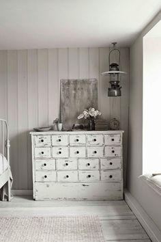 white vintage dresser, white wooden floor, white walls, white light  From the Free People blog