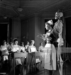 Nurse uses skeleton to teach anatomy at Royal Free Hospital class, London 1952
