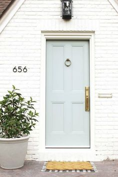 The Easy Guide to Exterior Front Door Styles and Types White Exterior Paint, White Exterior Houses, Exterior Paint Colors, Benjamin Moore Exterior Paint, Painted Exterior Doors, Stucco Colors, Exterior Design, Door Paint Colors, White Paint Colors