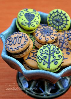 Spooktastically delightful orange and green Halloween Macarons. Maybe also Day-of-the-Dead themed Macarons too.