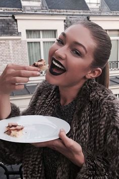 You don't need to reach for a box of Crest White Strips for a visibly brighter smile. Believe it or not, practically-black lips shades like Gigi's make your teeth look infinitely whiter. If you learned anything in art class, it's that you should trust the color wheel.