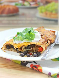 Skinny Bitch Tuesday: Spicy Black Bean Enchiladas - Eat. Drink. Love. - just made these tonight and they were probably the BEST vegetarian enchiladas I've ever had!