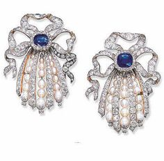 A PAIR OF IMPRESSIVE DIAMOND, SAPPHIRE AND PEARL BROOCHES Each designed as old mine-cut diamond ribbon bows to the central cushion-shaped sapphire suspending four graduated old mine-cut diamond tassels with graduated pearl tassel spacers, each with a floral terminal (with concealed pendent hoop), circa 1910. ($132,535)