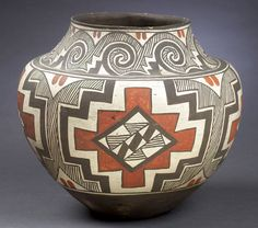 """Acoma Polychrome Storage Jar, (2002 American Indian Decorative Arts. September 27 - Cowans) )Circa 1920. With concave base, strong shoulder and short neck, decorated with black and red painted geometric devices on a cream slip, and with interior of neck with black paint; 12"""" high x 14"""" diameter. Sold: $7,475.00 Provenance:   De-accessioned From the Western Reserve Historical Society of Cleveland, Ohio."""