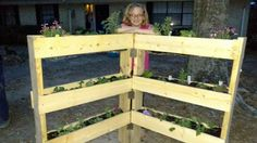 She staples chicken wire to a couple of 2x4's. When she turns it upright? This backyard idea is awesome!