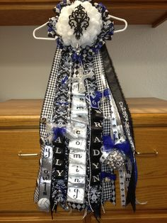 Damask Homecoming Mum, I know its a girly looking one but theres a lot of cool stuff, like the fluffy looking ribbons