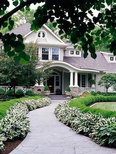 Edged walkway with easy-care plants like variegated hosta and boxwoods.