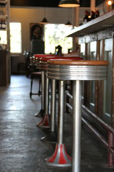 These would be perfect for our bar. Not sure how the landlord would feel about the bolting-into-the-floor business, though. Hmm.