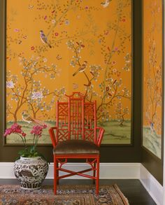Here mustard yellow walls featuring an oriental motif are teamed with stylised red furnitur, and plush rugs to create an eclectic Asian feel.
