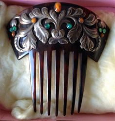 Georg Jensen First Period (1904 - 1908) comb. Amber and agate flower the silver leaves. Price: $16,000