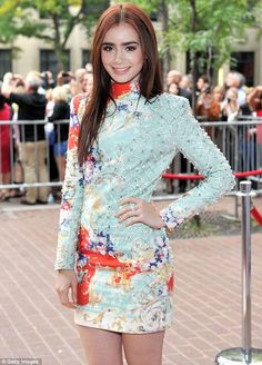 Lils... you looks especially ravishing in your pretty little dress! :-) #LilyCollins #fashion and #movies  Coming in the heir tonight! Lily Collins is stunning in colourful minidress as she and fellow celeb offspring Patrick Schwarzenegger premiere their film