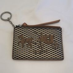 Coach Card Case Authentic Coach Card Case. Spots for cards, clear window on the back for an ID. Attached key ring so you can attach to a lanyard or to your keys. No flaws, barely used! Coach Bags Wallets