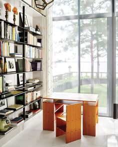 At a Minnesota house, a Donald Judd Desk 33 and Chair 84 face Lake Minnetonka. Photo by Douglas Friedman. Architectural Digest, Transformers, New York Loft, Kid Desk, Take A Seat, Decoration, Shelving, Furniture Design, Loft Furniture