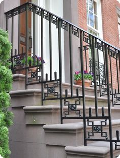 cool metal railing detail on NYC townhouse - from centsationalgirl