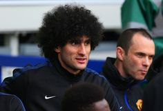 Marouane Fellaini of Manchester United looks on from the bench during the Barclays Premier League match between Everton and Manchester United at Goodison Park on April 20, 2014 in Liverpool, England