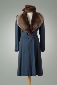 Blue wool twill winter coat with shawl collar of brown mouton. Object Number 07_04_39 Date Made 1939 Designer Bonwit Teller