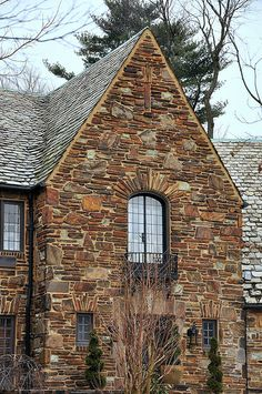 Stone house in Narberth, Pennsylvania...LOVE the slate roof.  Expensive when one gets broken, but they last forever otherwise.