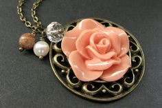 Peach Rose Charm Necklace. Rose Necklace. Gemstone Necklace. Flower Necklace. Handmade Jewelry. by StumblingOnSainthood from Stumbling On Sainthood. Find it now at http://ift.tt/1Ui5JKv!