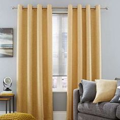 Crafted with a linen-effect texture, this pair of ochre yellow Vermont curtains feature an eyelet header and are fully lined to increase privacy. These contemporary curtains are available in a selection of widths and drop lengths. Grey And Yellow Living Room, Bedroom Yellow, Mustard And Grey Bedroom, Grey Yellow, Ready Made Eyelet Curtains, Curtains Dunelm, Contemporary Curtains, Bedroom Layouts, Bedroom Ideas
