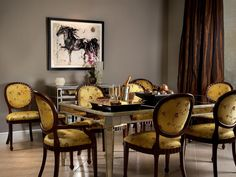yellow silk upholstered dining chairs create drama - not sure I love the fabric, but I love the style, plus paired with mirrored furniture.
