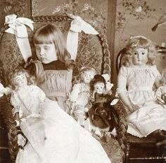A dead little girl surrounded by her dolls. Placing a child in a chair as if they had fallen asleep amongst their favorite toys was a common tableau in Victorian Momento Mori.