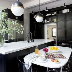 Black Kitchen Cabinets - Design photos, ideas and inspiration. Amazing gallery of interior design and decorating ideas of Black Kitchen Cabinets in kitchens by elite interior designers. Gray And White Kitchen, White Kitchen Decor, Kitchen Colors, Kitchen Interior, Gold Kitchen, Kitchen Wood, Kitchen Backsplash, Black Kitchen Cabinets, Black Kitchens