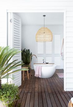 Years of hard work paid off for a Queensland couple whose love for landscaping and flair for interiors turned their beachside abode into a holiday-at-home oasis. Small Laundry Rooms, Laundry In Bathroom, Interior Styling, Interior Decorating, Interior Design, Timber Shelves, Timber Deck, Queenslander, Australian Homes