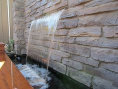 A water feature Kansas City/ landscape water features Kansas City may be indoor or outdoor and can be any size, from a desk top water fountain to a large indoor waterfall that covers an entire wall in.