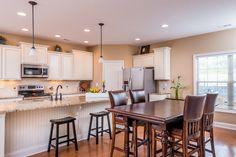 The kitchen of the Albany floor plan by Ball Homes.