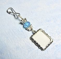 Check out Wedding bouquet photo charm for a bridal bouquet. Butterflies Photo charm with Aqua crystal. Bridal shower gift for a bride on smilingbluedog Blue Crystals, Crystal Beads, Small Picture Frames, Bouquet Charms, Spring Wedding Inspiration, Butterfly Photos, Butterfly Wedding, Star Wedding, Wedding Memorial