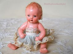 Old dollhouse baby doll, German vintage 1940s marked Hertwig Worms plastic small 2 3-4 inch baby doll with molded hair, original clothes by ShabbyGoesLucky on Etsy https://www.etsy.com/listing/231202715/old-dollhouse-baby-doll-german-vintage