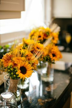 Bright fall blooms for a late September wedding! #Sunflowers #wheat #twine Bouquets: Flowers by Janie, Calgary Wedding Florist www.flowersbyjanie.com Photographer: Stephanie Koo Photography