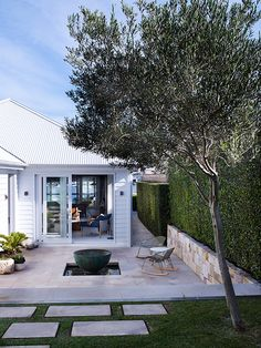 A STUNNING BEACHFRONT HOME IN SYDNEY | THE STYLE FILES...love everything but water feature...