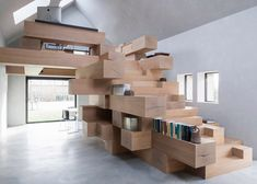 Studio Farris Architects has integrated an office into a staircase made from stacked timber beams, and installed it inside a renovated barn in West Flanders, Belgium.