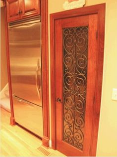 Faux iron on pantry door. Hmm idea for the kitchen Painted Pantry Doors, Painted Doors, Kitchen Cabinet Doors, Cupboards, Kitchen Cabinets, Cabinet Hardware, Tuscan Design, Tuscan Style, Wrought Iron Doors